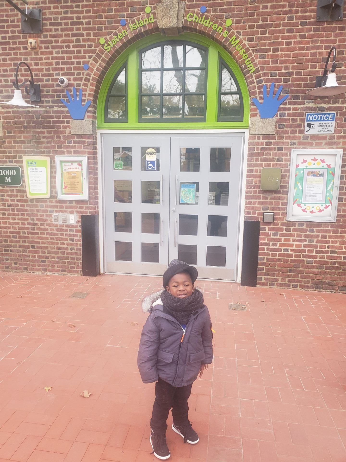 child standing outside the childrens museum with cool culture pass
