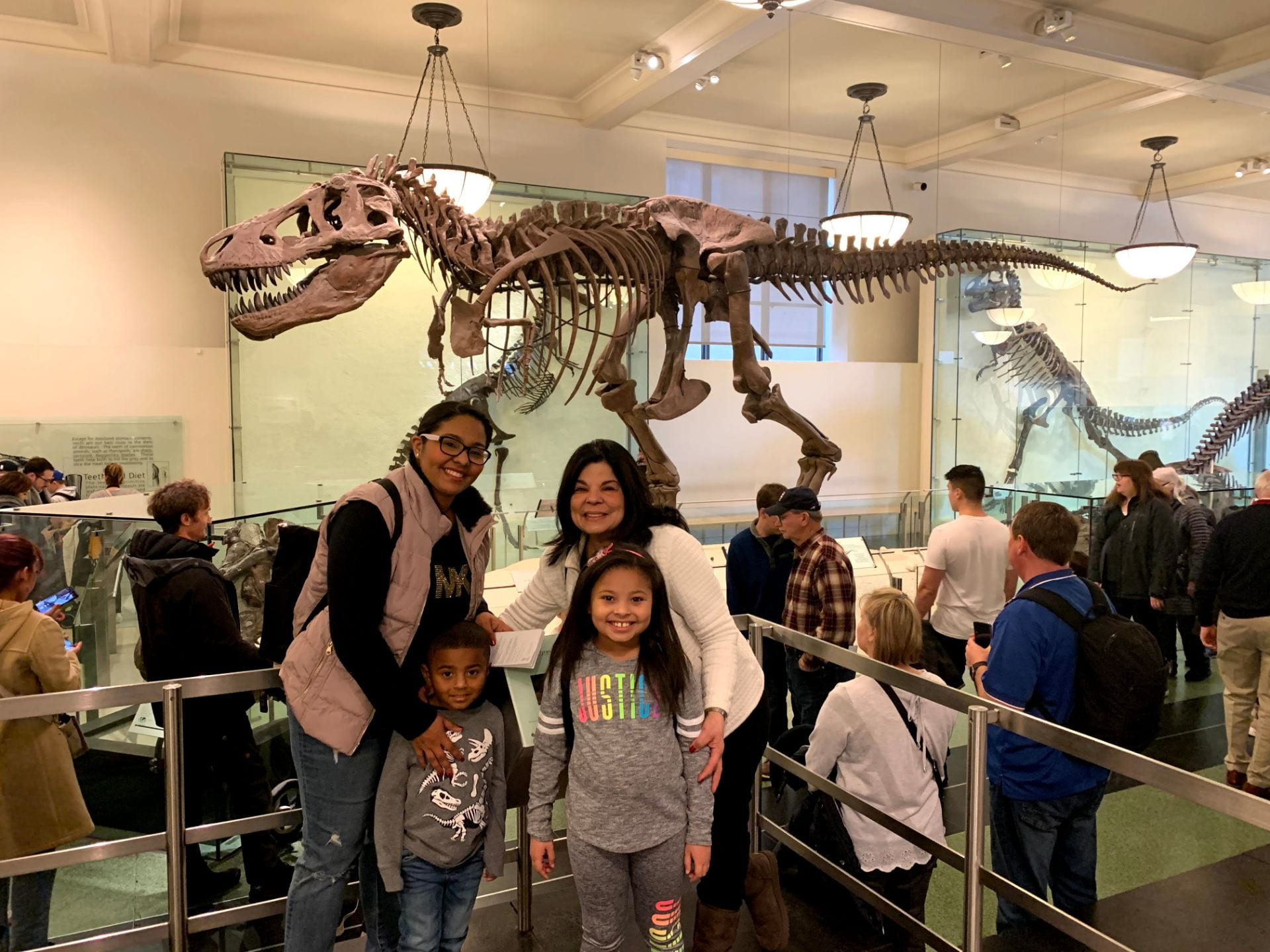 family posing for a photo at the museum of natural history