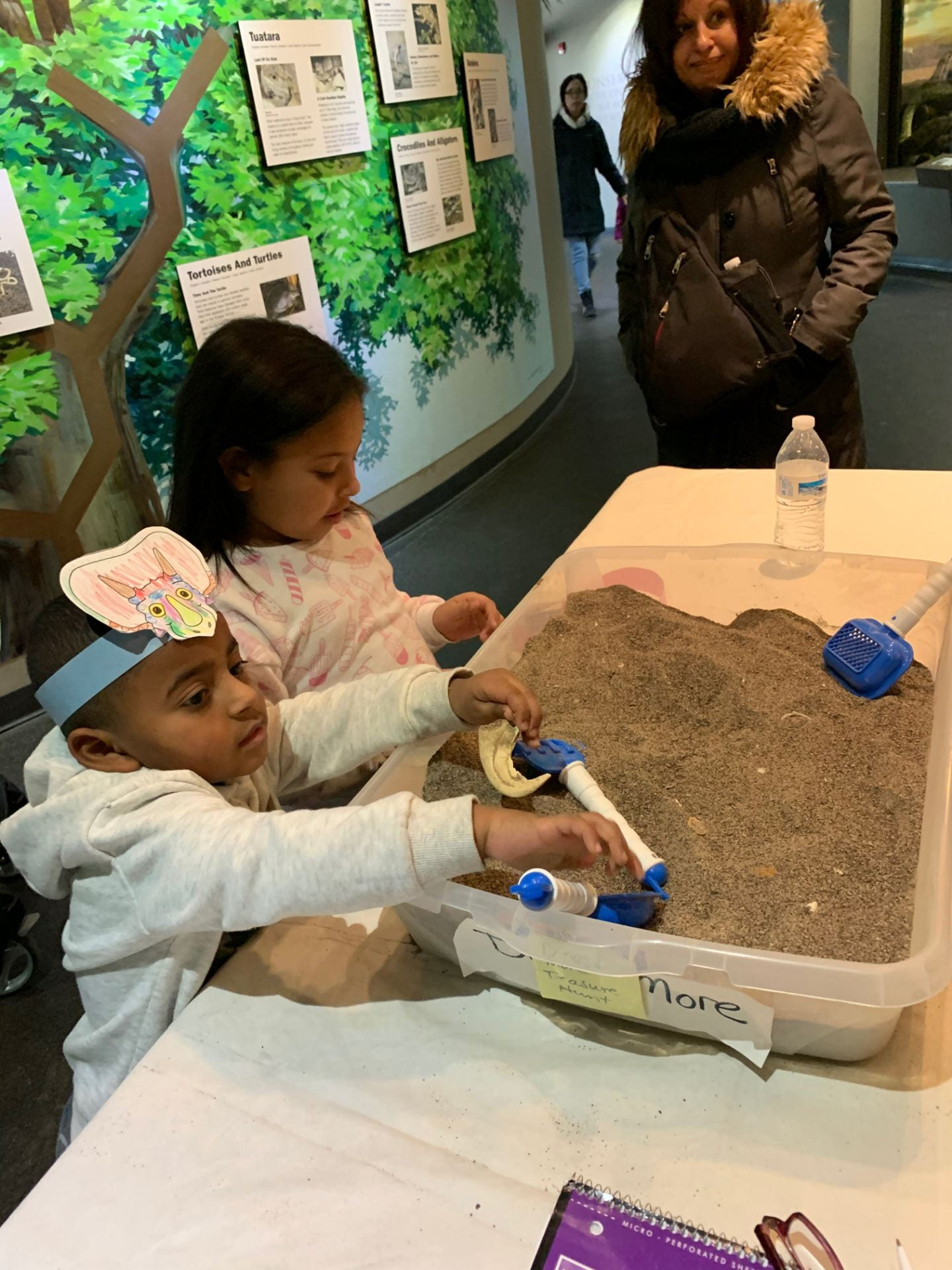 children exploring with sand at the children's museum