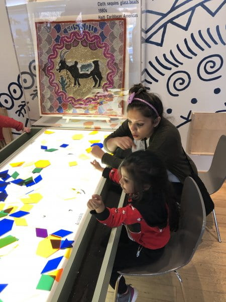 mommy and child using tangrams at the children's museum
